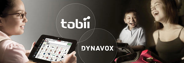A Tobii-DynaVox T10 device being used by a child, along with a two other users using DynaVox Vmax AAC devices