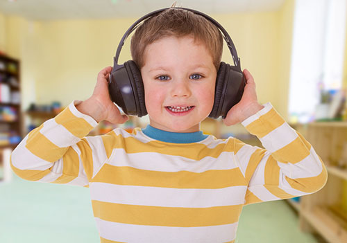 Boy with Headphones. Image courtesy of Texthelp US/Shutterstock