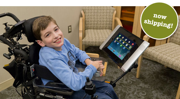 A child on a wheel chair with an iPad in a Connect Case mounted