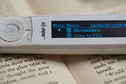 Close up of C-Pen Reader showing main menu on the display panel. Click to see larger image.